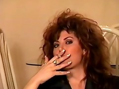 classic early 90s smokin with big hair, perfect.