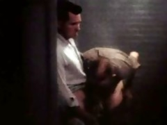 police spycam in a mensroom of the 50ies